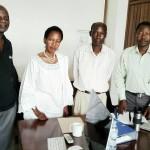 Mh. Anna Tibaijuka katika picha ya pamoja na wakili Dr Rugemeleza Nshala na Prince Bagenda katika ofisi za TAWLAT jijini Dar es salaam
